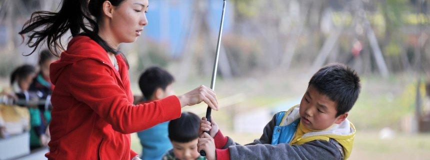 Chinesische Grundschüler müssen Golfen